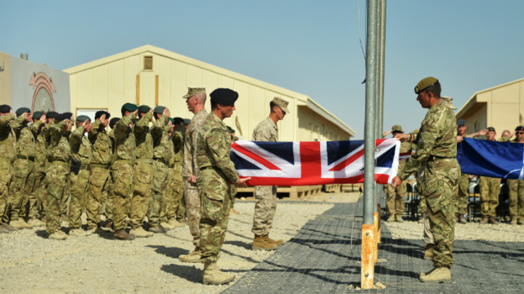 13 LONG YEARS. A handout image made available by British Defence Ministry, MOD, dated 26 October 2014 and showing British soldiers and US Marine Corps (USMC) soldiers attending the ceremony of the British, US and NATO flags being lowered at the Camp Bastion-Leatherneck camp complex for the last time in Afghanistan. Photo by EPA/SERGEANT OBI IGBO.