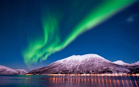 The northern lights occur when solar particles enter the Earth's atmosphere
