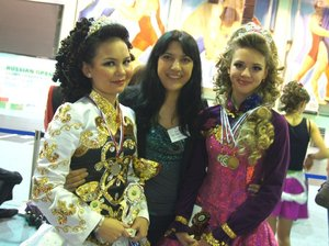Irish dancing teacher Darya Markosyan (center), from Russia, poses with two dancing students.