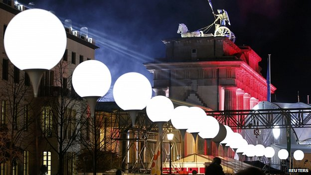 White balloons mark route of  Berlin Wall close to Brandenburg Gate. 8 Nov 2014 Illuminated white balloons, seen here near the Brandenburg Gate, mark the route of the Berlin Wall