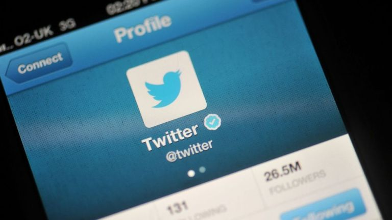 The Twitter logo is displayed in a photo illustration on a mobile device, Nov. 7, 2013 in London. Bethany Clarke/Getty Images