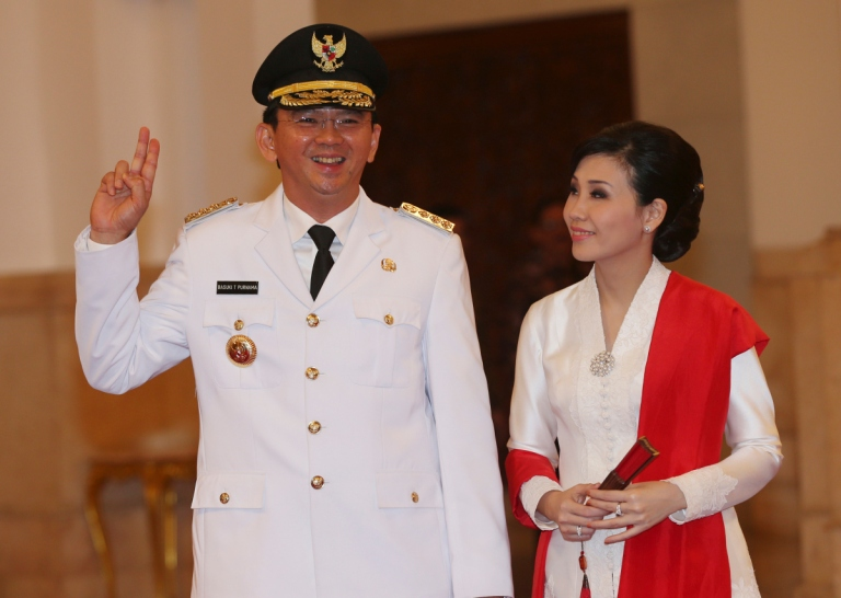 Basuki Tjahaja Purnama, with his wife Veronica Tan, poses prior to taking the oath of office to become the governor of Indonesia's capital Jakarta on Nov. 19, 2014 Tatan Syuflana—AP