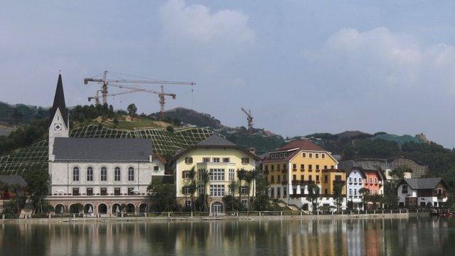 In this image, developers work on creating a replica of the Austrian village of Hallstatt, a UNESCO World Heritage Site, in Guangdong.