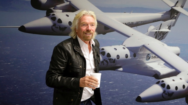Virgin Galactic founder Richard Branson's space tourism rocket exploded and crashed Friday, killing one person and seriously injuring another. A second craft being built for Virgin is about per cent complete. Virgin Galactic founder Richard Branson's space tourism rocket exploded and crashed Friday, killing one person and seriously injuring another. A second craft being built for Virgin is about per cent complete. (Reed Saxon/Associated Press)